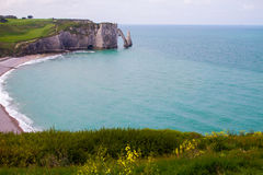 Etretat cliffs, France. Etretat  chalk cliffs, including three natural arches and a pointed formation called L`Aiguille or the Needle.  Seine-Maritime department Royalty Free Stock Photo