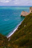 Etretat cliffs, France. Etretat  chalk cliffs, including three natural arches and a pointed formation called L`Aiguille or the Needle.  Seine-Maritime department Stock Photos
