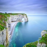 Etretat, Manneporte natural rock arch and its beach. Normandy, F. Etretat, la Manneporte natural rock arch wonder, cliff and beach. Long exposure photography Royalty Free Stock Photos