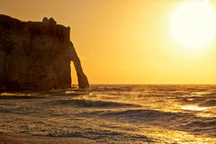 Etretat, Porte d'Aval natural arch at sunset Royalty Free Stock Photography