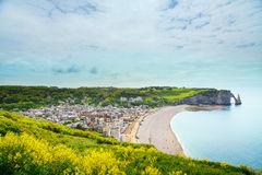Etretat village, beach and Aval cliff landmark on ocean. Normand Stock Images