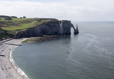 Etretat village, its bay beach and Aval cliff. Landmark Aerial view Normandy, France, Europe Stock Photos