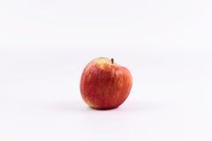 Ett äpple på en vit bakgrund Royaltyfri Bild