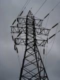 Ett överföringstorn (elektricitetspylonen) Royaltyfria Bilder