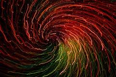 Ett abstrakt fotografi av den ljusa kulöra spiralen fodrar Arkivbild