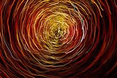 Ett abstrakt fotografi av den ljusa kulöra spiralen fodrar Royaltyfri Foto