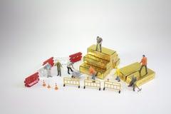 ett arbetardiagram flyttning av gulden, Arkivbild