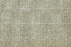 Ett ark av forntida lagt papper som bakgrund arkivbild