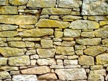Ett avsnitt av en stenvägg arkivbild