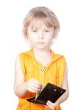 Ett barn med en handväska och dollarräkningar Arkivfoto