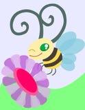 Ett bi och en blomma Arkivbild