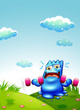 Ett blått monster som övar på bergstoppet Arkivfoto