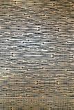 Ett bronsväggsmattrande planlade att se som den forntida papyruset arkivfoto