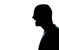 Ett caucasian skrika för profil för manståendekontur som är ilsket i studio på vit bakgrund Arkivbilder