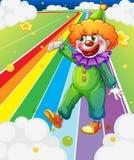 Ett clownanseende i den färgrika vägen Arkivbilder