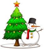 Ett enkelt skissar av en snögubbe bredvid julgranen Arkivfoton