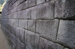 Ett exempel av enbyggd vägg i Machu Picchu, Peru Arkivbild