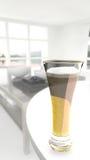 Ett exponeringsglas av öl Arkivfoton