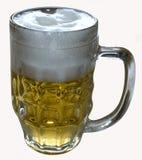 Ett exponeringsglas av öl med skum Arkivfoto