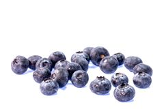 ett exponeringsglas av blåbäret i blått vatten Royaltyfria Bilder