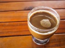 Ett exponeringsglas av kaffe arkivbilder