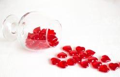 Ett exponeringsglas av röda hjärtor Royaltyfri Foto