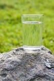 Ett exponeringsglas av vatten Arkivbilder