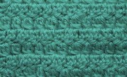 Ett foto av en virkad textil arkivfoto