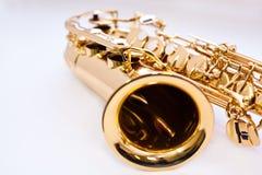 Ett fragment av en saxofon Fotografering för Bildbyråer