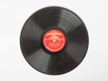 Ett gammalt grammofonrekord i en räkning med en sikt av Kreml, minnet av Aprelevskiy 1905 P Royaltyfri Foto