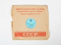 Ett gammalt grammofonrekord i räkningen av minnet av den Aprelevskiy växten 1905 Royaltyfri Foto