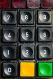 Ett gammalt numeriskt tangentbord med extra knappar arkivfoton