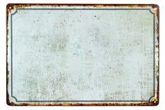 Ett gammalt tomt rostigt metalltecken royaltyfri foto