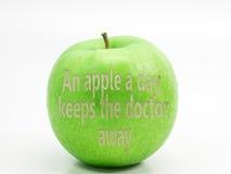 Ett grönt äpple II Arkivbild