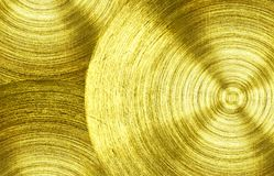 Ett guld- järn för metall med rund texturbakgrund arkivfoton