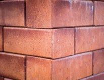 Ett hörn av väggen för röd tegelsten Royaltyfri Foto