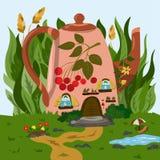 Ett hemtrevligt litet hus i en tekanna i gräset Fotografering för Bildbyråer