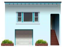 Ett hus med en trappa och ett garage Fotografering för Bildbyråer