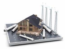 Ett hus på en solpanel, tillsammans med väderkvarnar och ritningar omkring Arkivfoton