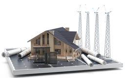 Ett hus på en solpanel, tillsammans med väderkvarnar och ritningar omkring Arkivbild