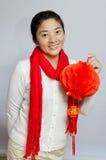 Ett kinesiskt felanmälan för nytt år för kvinnapay Fotografering för Bildbyråer