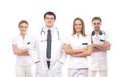Ett lag av unga Caucasian medicinska arbetare Arkivfoto