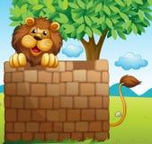 Ett lejon inom en hög av tegelstenar stock illustrationer