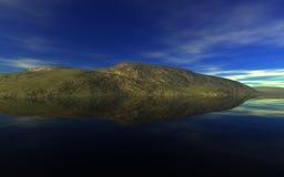 Ett litet löst en ö på horisont Royaltyfria Foton