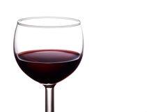 Ett lyxigt enkelt exponeringsglas av rikt, mörker - rött vin är royaltyfria foton