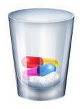 Ett mäta exponeringsglas med kapslar och minnestavlor vektor illustrationer