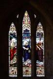 Ett målat glassfönster Matthew 4 19 Arkivfoto