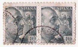 Ett par av gamla blåa tappningportostämplar med en bild av generalen franco och det spanska örnsymbolet Royaltyfria Foton