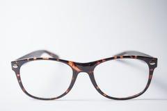 Ett par av moderiktigt brunt glasögon Royaltyfri Fotografi