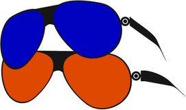 Ett par av solglasögon i rött och blått Royaltyfri Foto